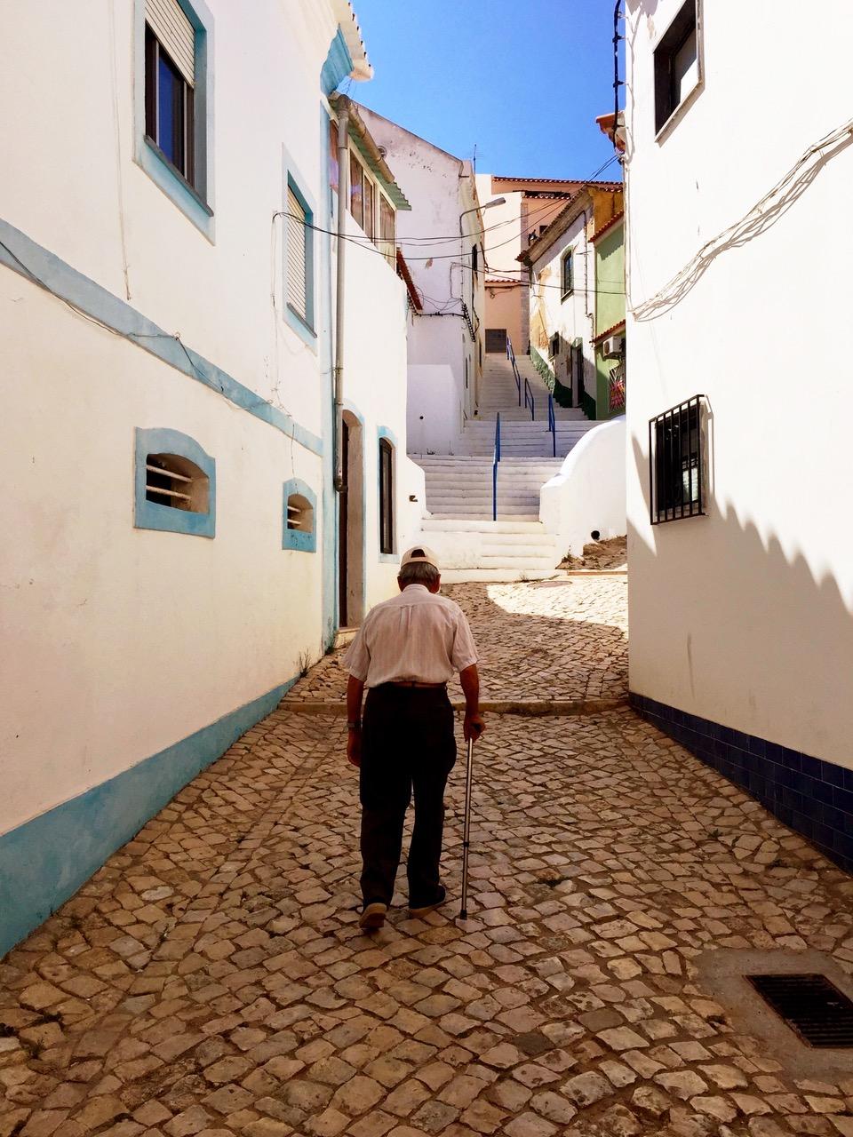 Walking the narrow streets of Ferragudo, Algarve, Portugal