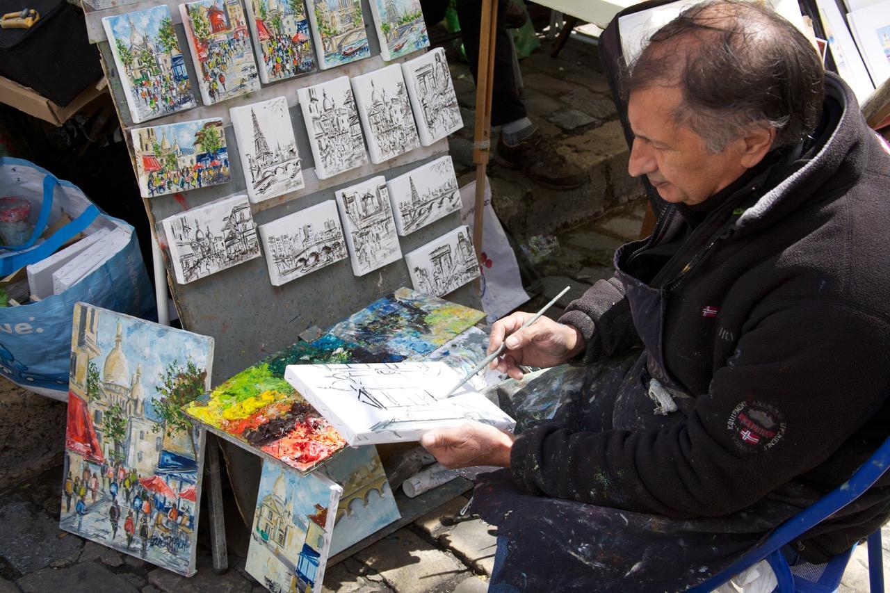 Sketch artist at Place du Tetre in Paris