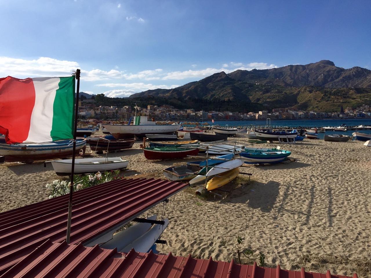 Beach with fishing boats at Giardini Naxos, Sicily