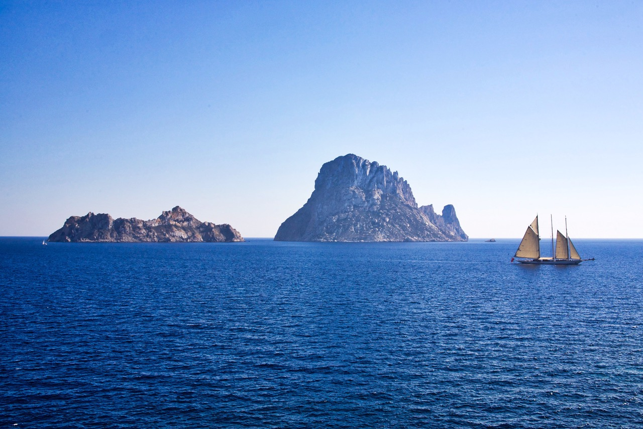Wonderful view on Es Vedra with classic sail boat, Ibiza