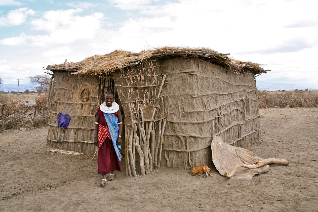 Very friendly Maasai woman showing home