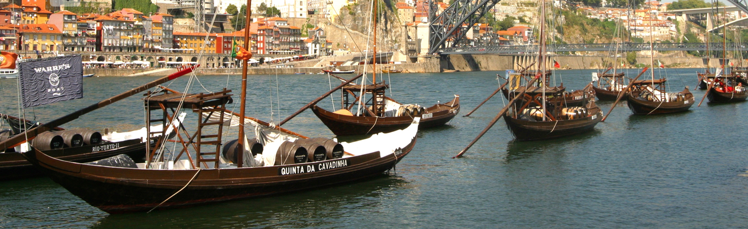 Rabelo boats waiting for Port along the Douro River