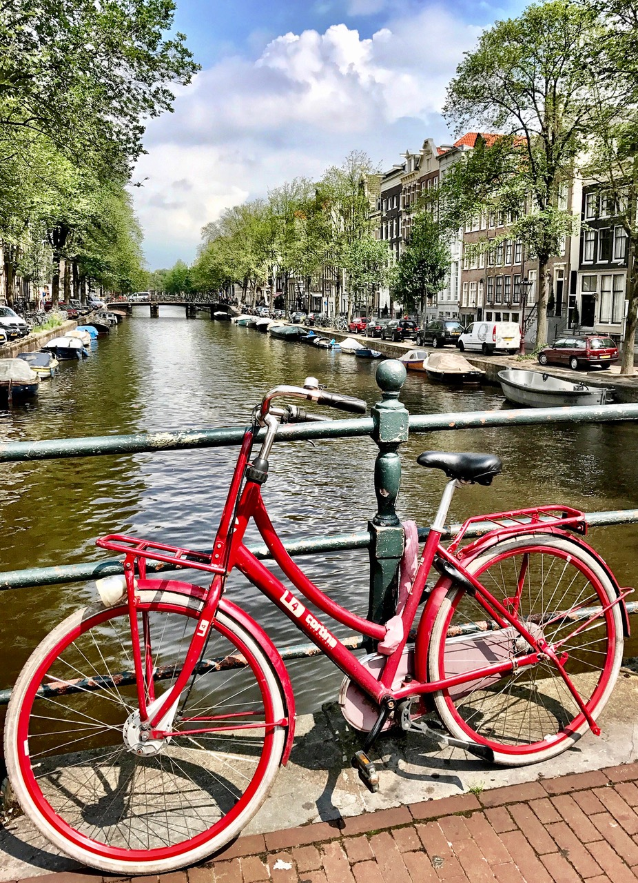 Red bike, canals, Amsterdam, The Netherlands