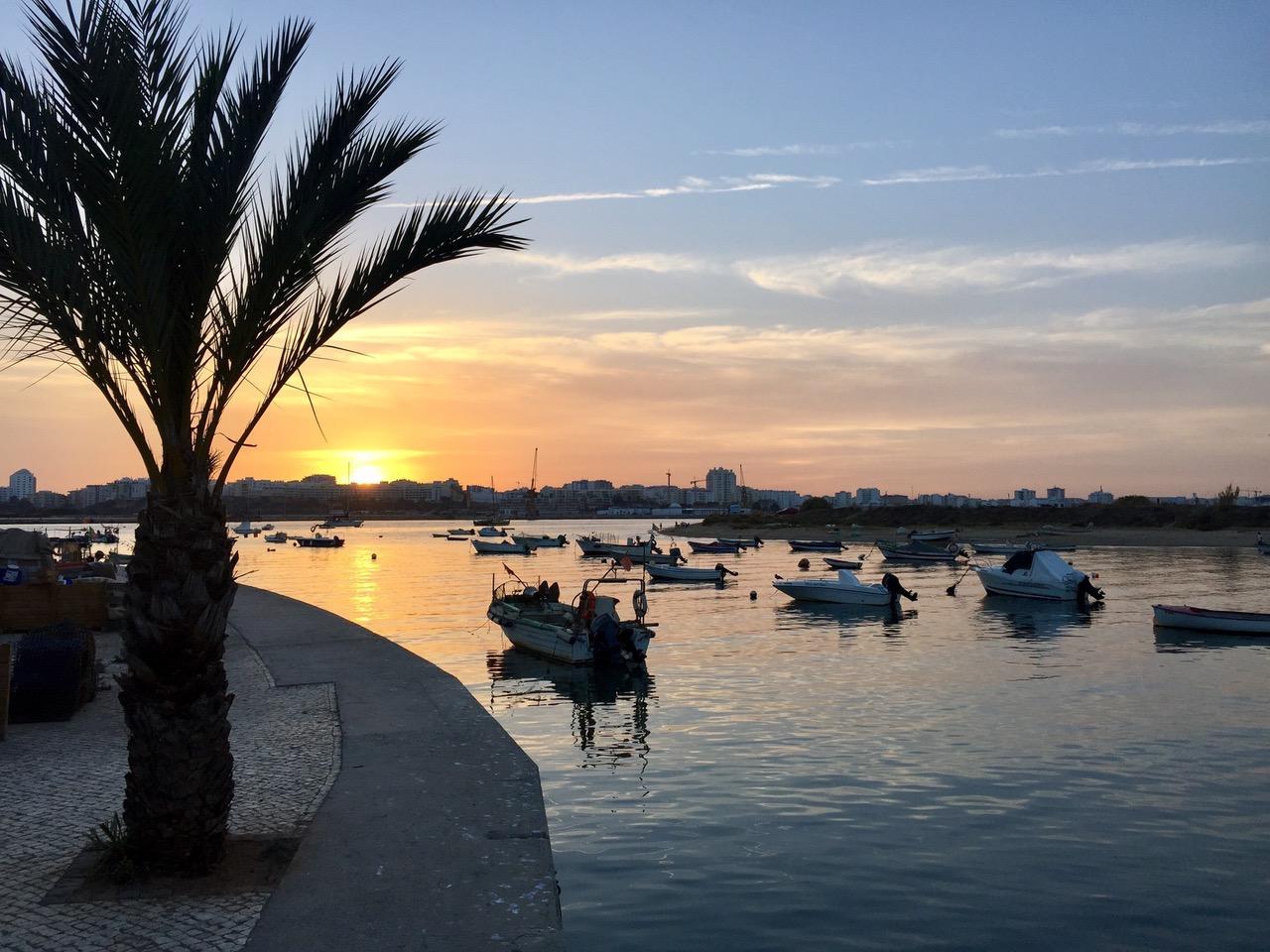 Sunset at Ferragudo harbor, Algarve, Portugal