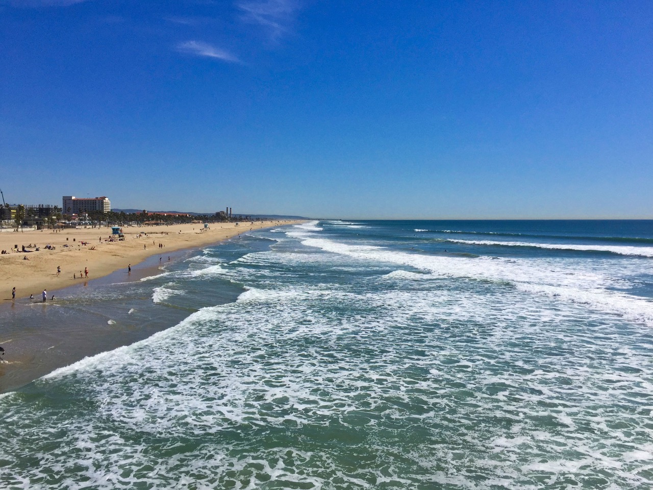 Catching waves at Huntington Beach, California