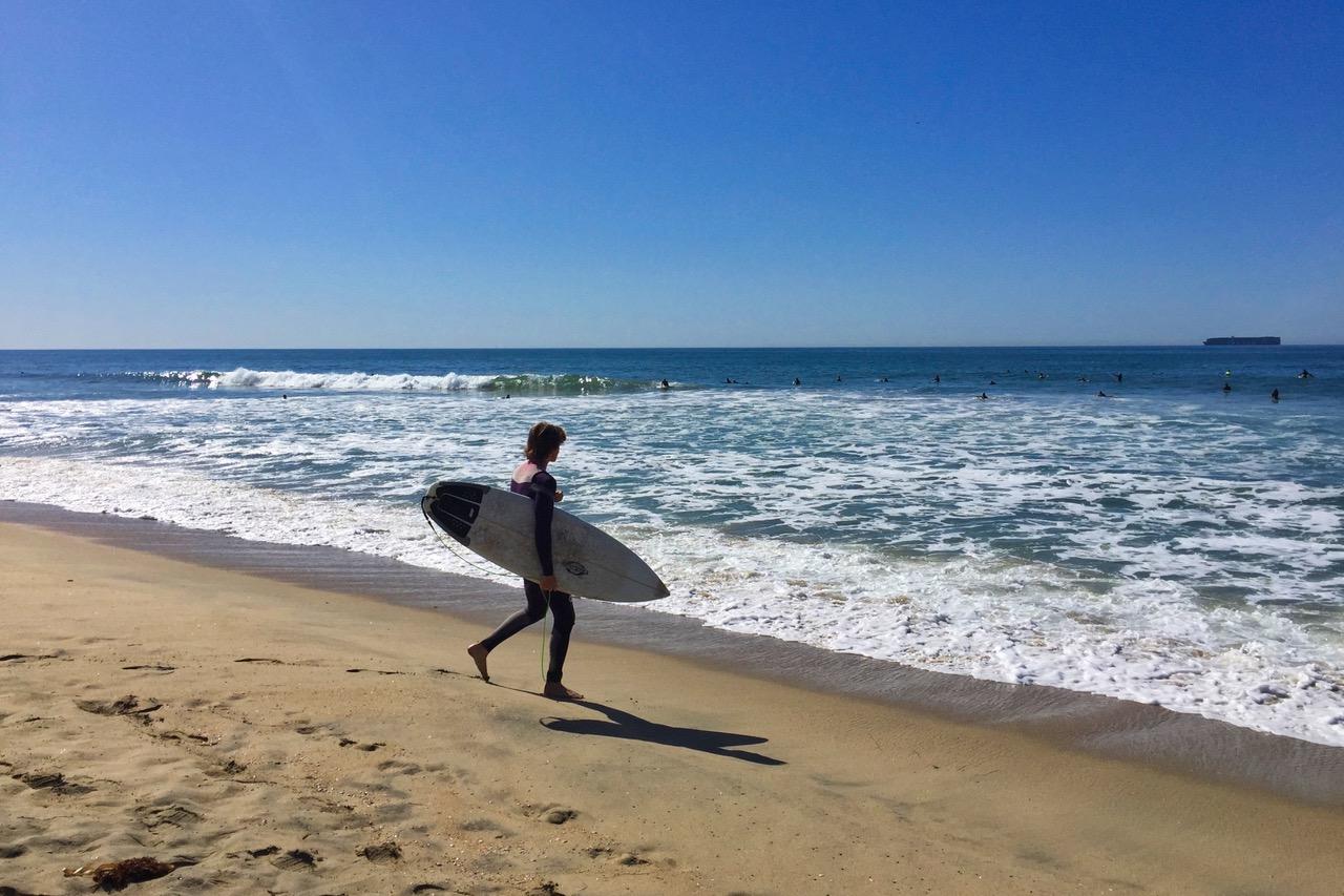 Surfer on Huntington Beach, Surf City, California