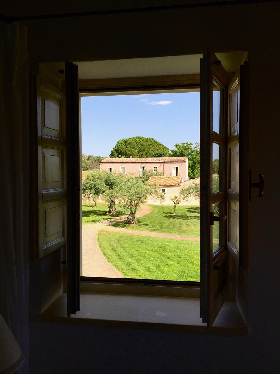 Window view at Masseria Degli Ulivi in San Corrado di Fuori, Sicily