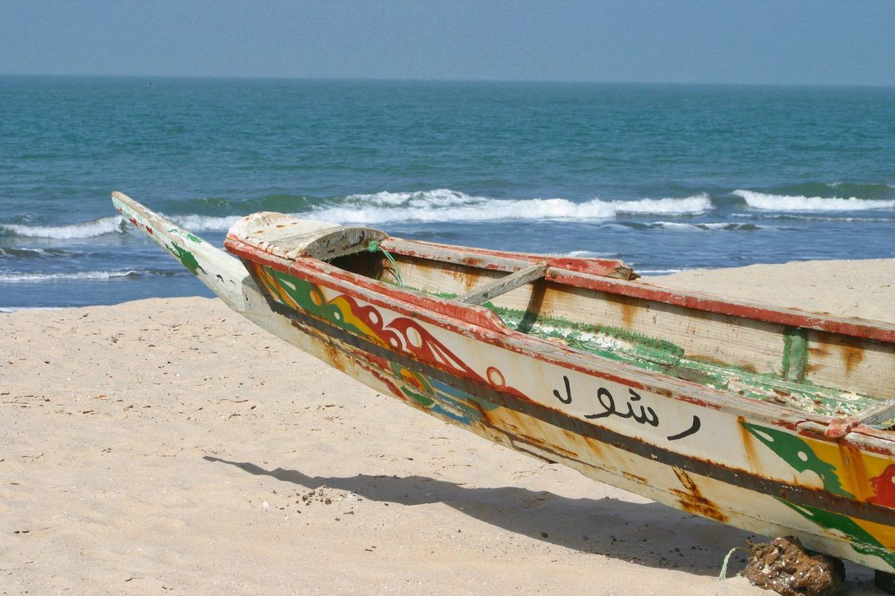 Traditional fishing boat at Kololi Beach in Gambia