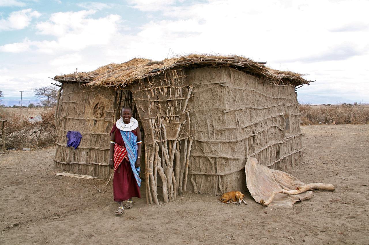 Very friendly Maasai woman showing home