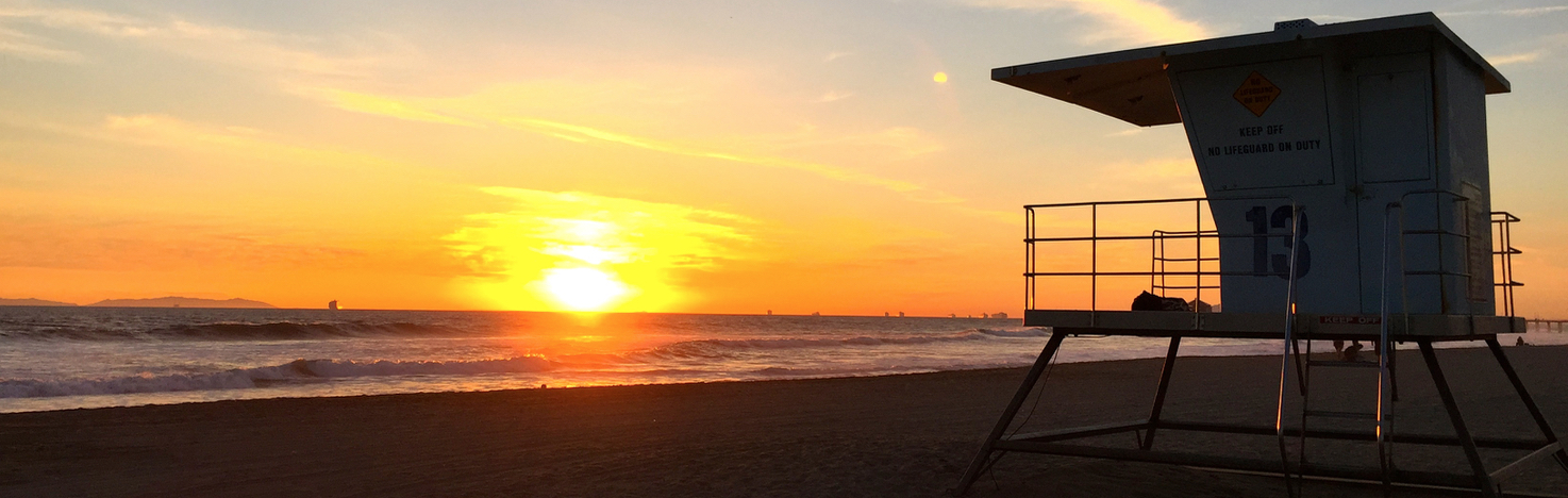 Sunset Huntington Beach with life guard tower in front