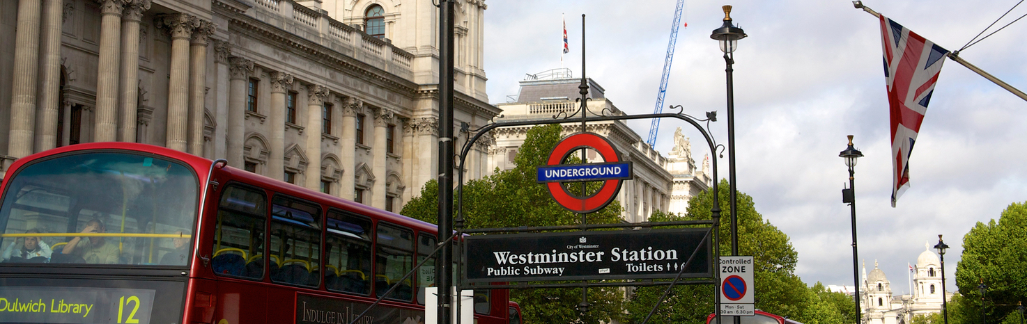 London street view with buss, underground and flag