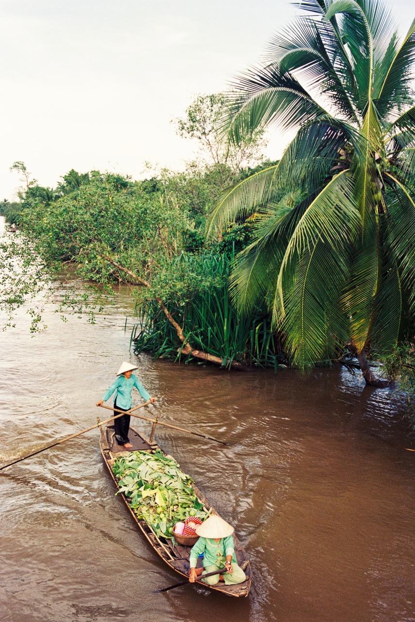 Woman padding a boat near Nha Trang, Vietnam